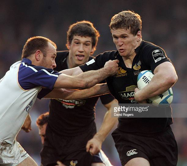 Tom Rees of Wasps hold off Chris Whitaker during the Heineken Cup quarter final match between London Wasps and Leinster at Adams Park on March 31...