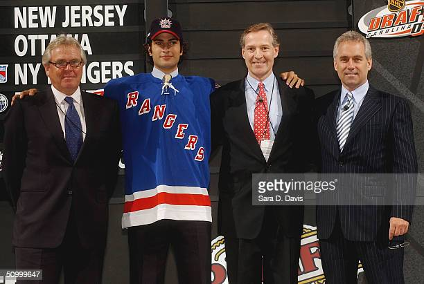 Tom Renney, #6 overall draft pick Al Montoya, assistant GM Don Maloney and general manager Glen Sather of the New York Rangers pose during the 2004...