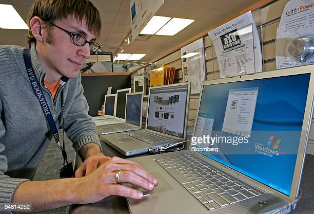 Tom ReyesCairo an employee at the Brigham Young University Bookstore runs Windows XP Professional on an Apple MacBook Pro after installing 'Boot...