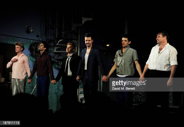 Tom Rhys Harries Ben Whishaw Rupert Grint Daniel Mays Colin Morgan and Brendan Coyle bow at the curtain call during the press night performance of...