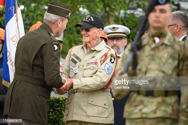 Tom Rice a 97yearold DDay veteran is greeted during a ceremony to mark the 75th anniversary of the DDay landings on June 05 2019 in Carentan France...