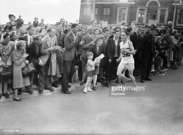 Tom Richards of Great Britain entering Olympic Way in third place at the end of the marathon event at the Olympic Games London 7th August 1948...