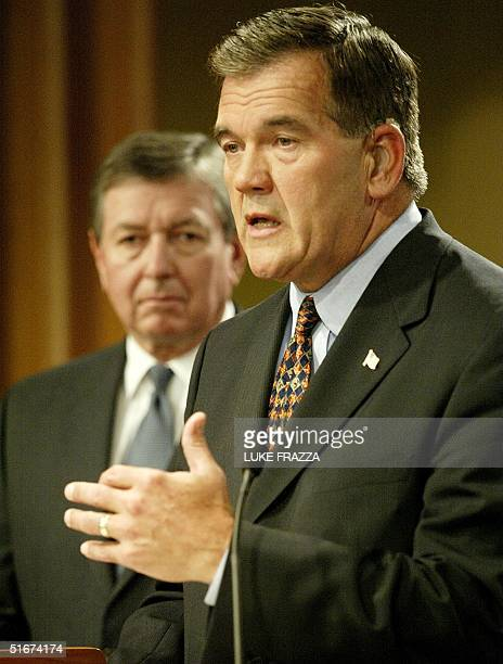 Tom Ridge Director of Homeland Security and US Attorney General John Ashcroft answer reporters' questions 10 September 2002 at the Justice Department...