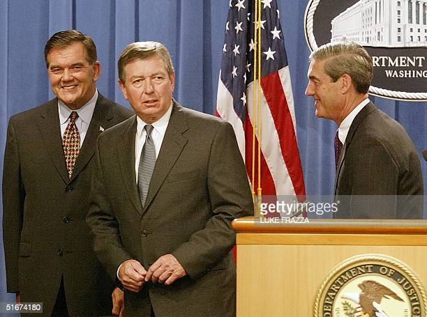Tom Ridge Director of Homeland Security and US Attorney General John Ashcroft and FBI Director Robert Mueller finish a press conference 10 September...