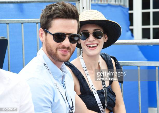 Tom Riley and Lizzy Caplan celebrate with Moet Ice Imperial in the Moet Chandon Suite whilst watching the action unfold on Centre Court at the Aegon...