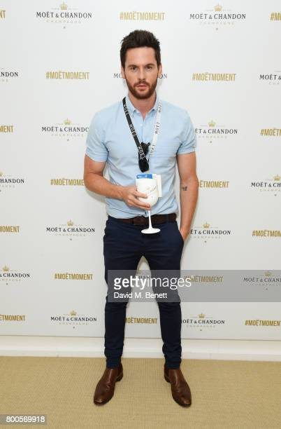Tom Riley celebrates with Moet Ice Imperial in the Moet Chandon Suite whilst watching the action unfold on Centre Court at the Aegon Championships...