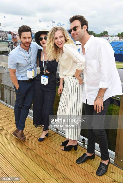 Tom Riley Lizzy Caplan Portia Freeman and Pete Denton celebrate with Moet Ice Imperial in the Moet Chandon Suite whilst watching the action unfold on...