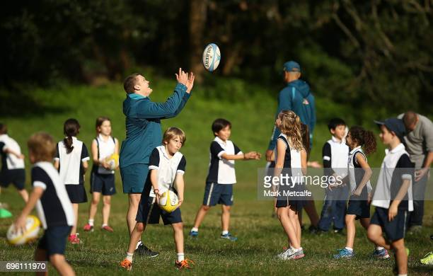 Tom Robertson instructs local school children during an Australian Wallabies media opportunity at Lough Playing Fields on June 15 2017 in Sydney...