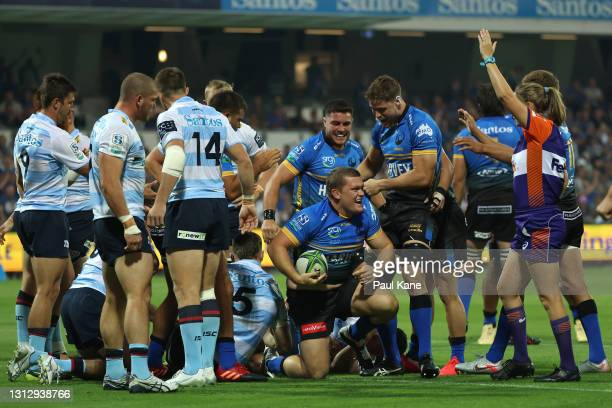 Tom Robertson of the Force celebrates crossing for a try during the round nine Super RugbyAU match between the Western Force and the NSW Waratahs at...