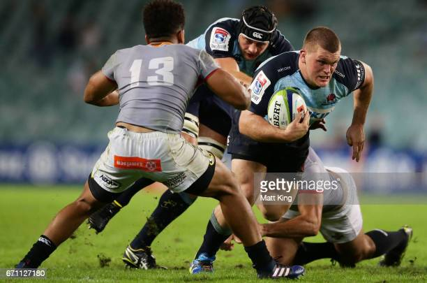 Tom Robertson of the Waratahs takes on the defence during the round nine Super Rugby match between the Waratahs and the Kings at Allianz Stadium on...