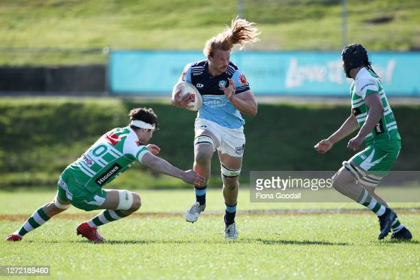 Tom Robinson of Northland fends the defenders during the round 1 Mitre 10 Cup match between Northland and Manawatu at Semenoff Stadium on September...