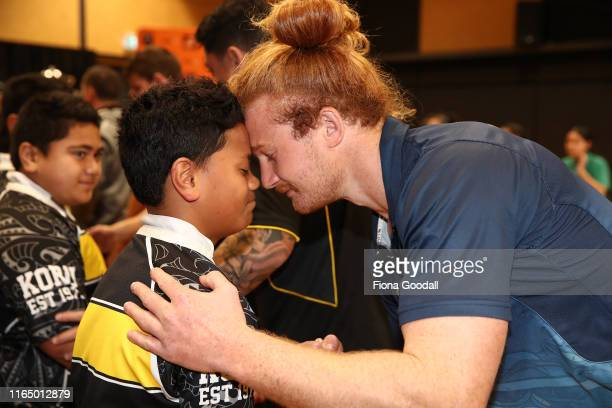 Tom Robinson of Northland is greeted with a hongi by students at Koru School in Mangere during the Mitre 10 Cup Launch on July 30 2019 in Auckland...
