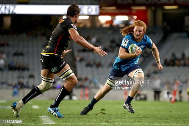 Tom Robinson of the Blues is tackled during the round 7 Super Rugby match between the Blues and the Stormers at Eden Park on March 30 2019 in...