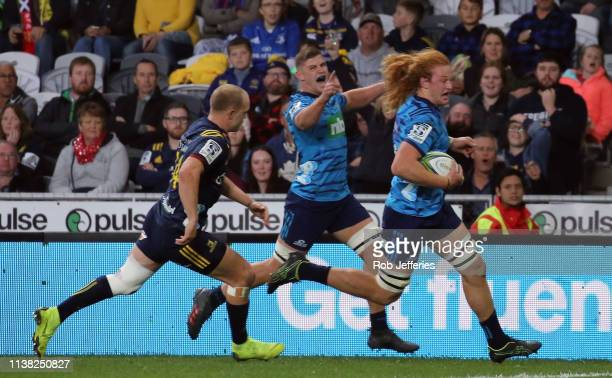 Tom Robinson of the Blues on his way to his try during the round 10 Super Rugby match between the Highlanders and the Blues at Forsyth Barr Stadium...