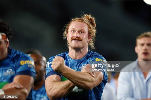 Tom Robinson of the Blues performs a haka for teammate Ofa Tuungafasi on his 100th game after the round 6 Super Rugby Aotearoa match between the...