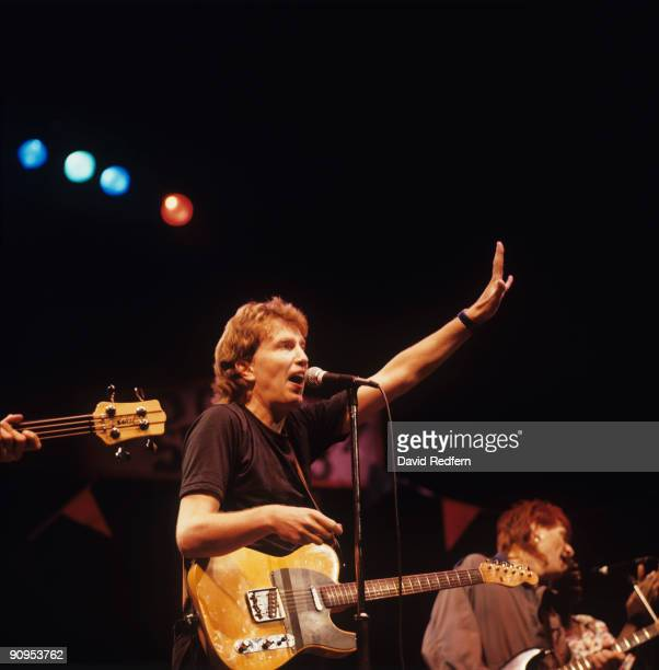 Tom Robinson performs on stage in London England in October 1984
