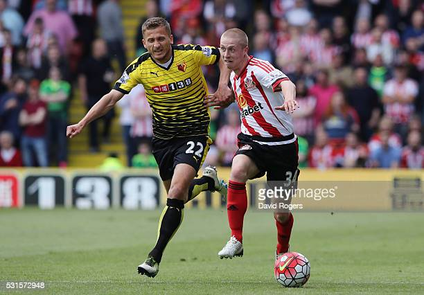 Tom Robson of Sunderland and Almen Abdi of Watford compete for the ball during the Barclays Premier League match between Watford and Sunderland at...