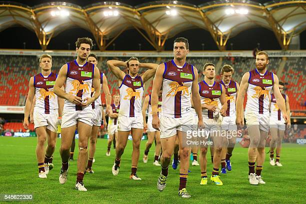 Tom Rockliff and the Lions leave the field after losing the round 16 AFL match between the Gold Coast Suns and the Brisbane Lions at Metricon Stadium...