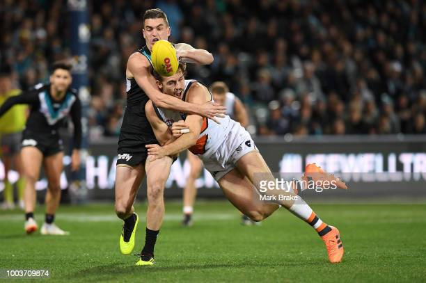 Tom Rockliff of Port Adelaide competes with Phil Davis of the Giants during the round 18 AFL match between the Port Adelaide Power and the Greater...