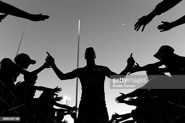 Tom Rockliff of the Lions celebrates victory with fans after the round 21 AFL match between the Brisbane Lions and the Carlton Blues at The Gabba on...