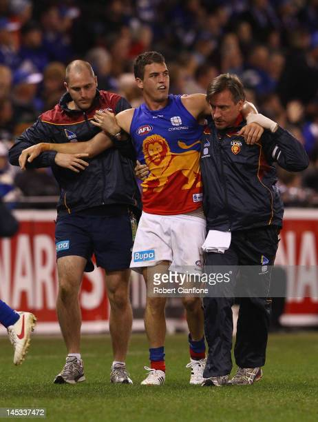 Tom Rockliff of the Lions is taken from the ground with an injury during the round nine AFL match between the North Melbourne Kangaroos and the...