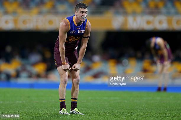 Tom Rockliff of the Lions looks on after losing the round 17 AFL match between the Brisbane Broncos and the Greater Western Sydney Giants at The...