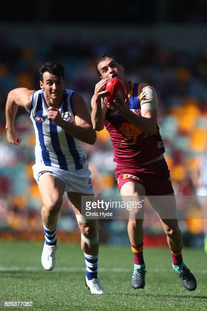 Tom Rockliff of the Lions takes a mark during the round 23 AFL match between the Brisbane Lions and the North Melbourne Kangaroos at The Gabba on...