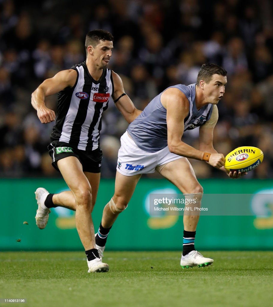 Tom Rockliff Of The Power And Scott Pendlebury Of The Magpies In