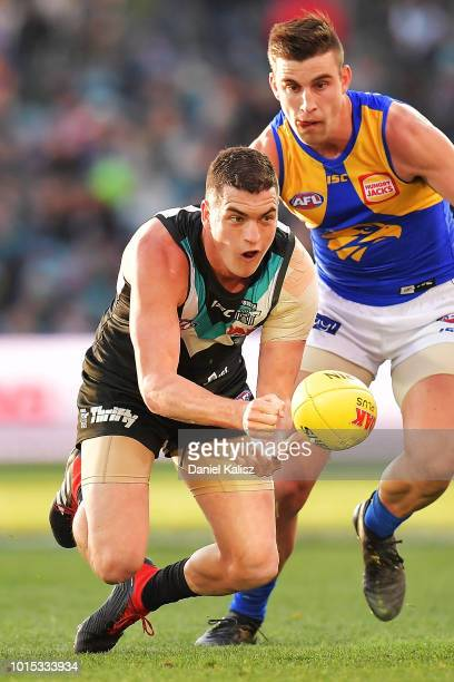 Tom Rockliff of the Power handballs during the round 21 AFL match between the Port Adelaide Power and the West Coast Eagles at Adelaide Oval on...