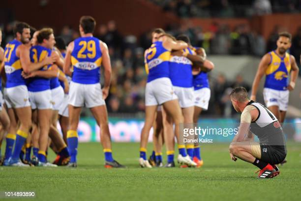 Tom Rockliff of the Power looks on dunks after the round 21 AFL match between the Port Adelaide Power and the West Coast Eagles at Adelaide Oval on...
