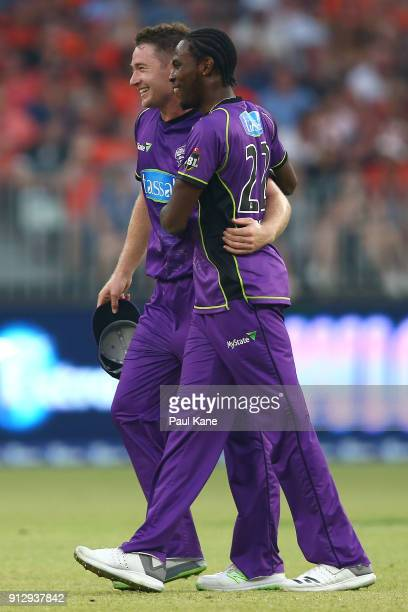 Tom Rogers and Jofra Archer of the Hurricanes celebrate the wicket of Shaun Marsh of the Scorchers during the Big Bash League Semi Final match...
