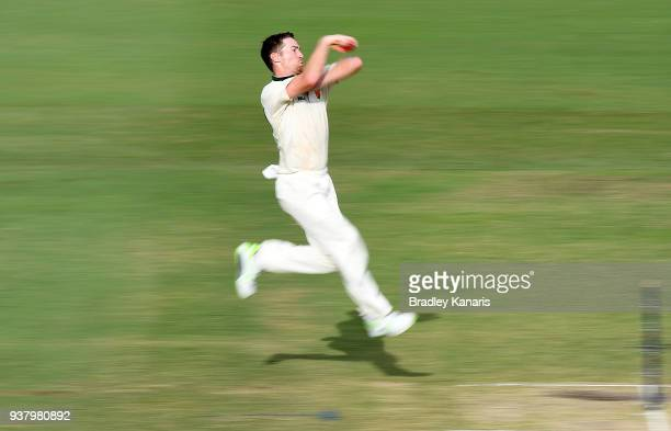 Tom Rogers of Tasmania bowls during day four of the Sheffield Shield Final match between Queensland and Tasmania at Allan Border Field on March 26...