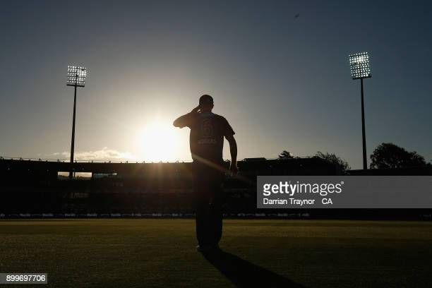 Tom Rogers of the Hobart Huuicanes looks into the sun during the Big Bash League match between the Hobart Hurricanes and the Sydney Thunder at...