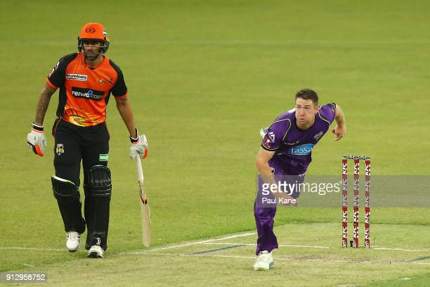 Tom Rogers of the Hurricanes bowls during the Big Bash League Semi Final match between the Perth Scorchers and the Hobart Hurricanes at Optus Stadium...