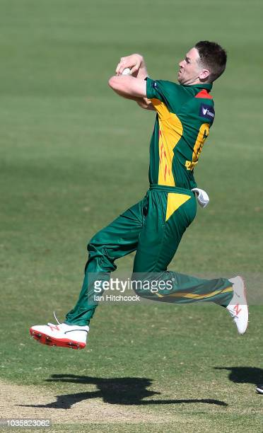Tom Rogers of the Tigers bowls during the JLT One Day Cup match between Tasmania and Victoria at Riverway Stadium on September 19 2018 in Townsville...