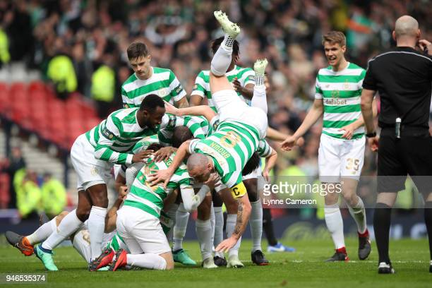 Tom Rogic and Scott Brown of Celtic celebrate during the Scottish Cup Semi Final between Rangers and Celtic at Hampden Park on April 15 2018 in...