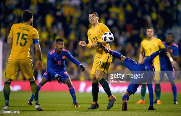Tom Rogic of Australia blocks Mateus Uribe of Columbia pass during the International friendly between Australia and Colombia at Craven Cottage on...