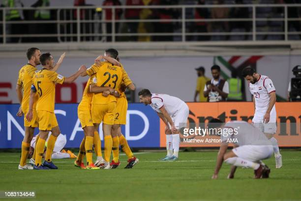 Tom Rogic of Australia celebrates after scoring a goal to make it 3-2 during the AFC Asian Cup Group B match between Australia and Syria at Khalifa...