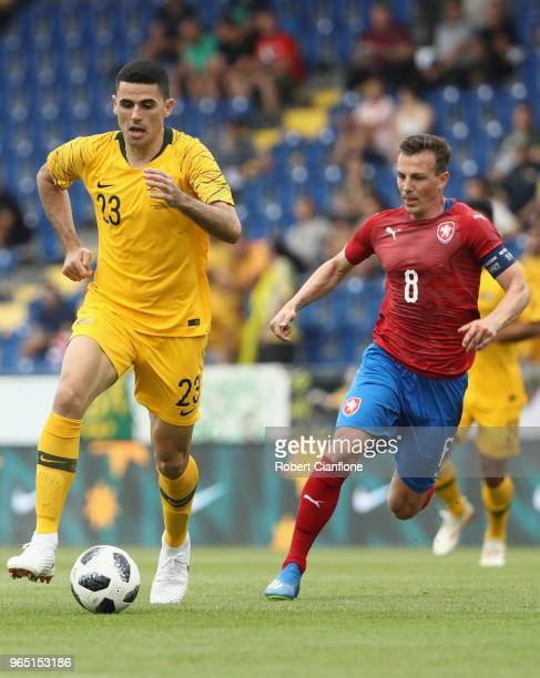 Tom Rogic of Australia is chased by Vladimir Darida during the International Friendly match between the Czech Republic and Australia Socceroos at NV...