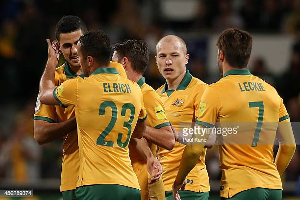 Tom Rogic of Australia is congratulated by Tarek Elrich after scoring during the 2018 FIFA World Cup Qualification match between the Australian...
