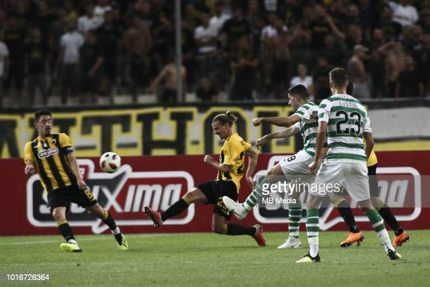 Tom Rogic of Celtic battles for the ball during the UEFA Champions League Qualifying Third Round 2nd Leg match between AEK Athens and Celtic at OAKA...