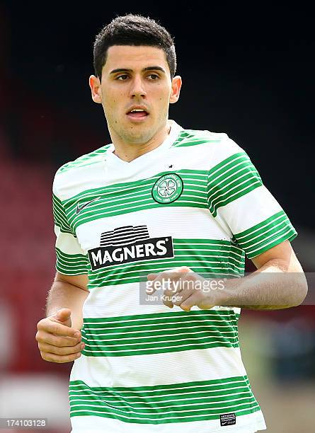 Tom Rogic of Celtic in action during a pre season friendly match between Brentford and Celtic at Griffin Park on July 20 2013 in Brentford England