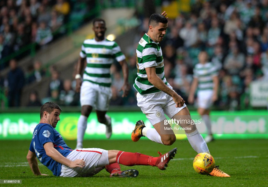 Tom Rogic of Celtic is challenged by Mark Haughey of Linfield during the UEFA Champions League Qualifying Second Round, Second Leg match between Celtic and Linfield at Celtic Park Stadium on July 19, 2017 in Glasgow, Scotland.