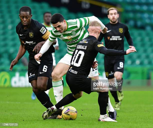 Tom Rogic of Celtic is challenged by Marvin Bartley of Livingston FC and Craig Sibbald of Livingston FC during the Ladbrokes Scottish Premiership...