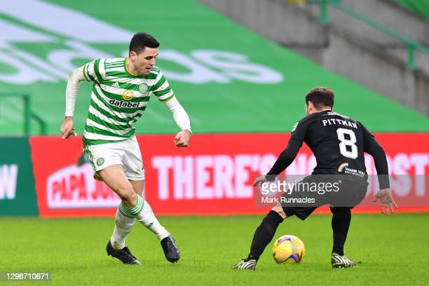 Tom Rogic of Celtic is challenged by Scott Pittman of Livingston FC during the Ladbrokes Scottish Premiership match between Celtic and Livingston at...