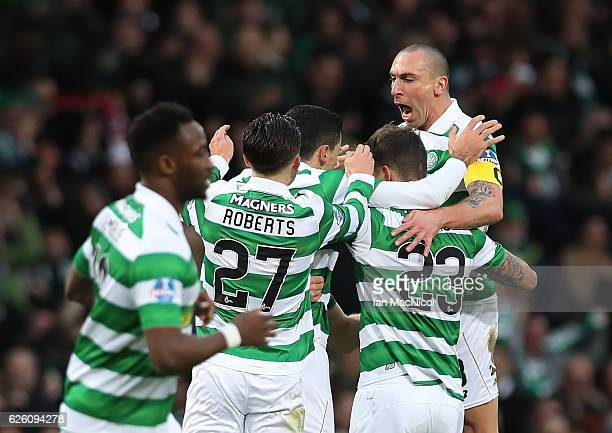 Tom Rogic of Celtic is congratulated by team mates after he scores true opening goal during the Betfred Cup Final between Aberdeen and Celtic at...