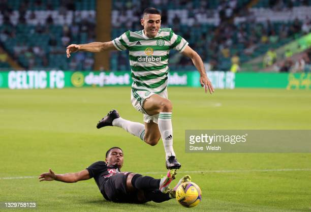 Tom Rogic of Celtic is tackled by Evander of FC Midtylland during the UEFA Champions League Second Qualifying Round First Leg between Celtic and FC...