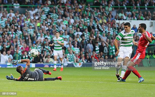 Tom Rogic of Celtic scores the opening goal during the UEFA Champions League Playoff First leg match between Celtic and Hapoel BeerSheva at Celtic...