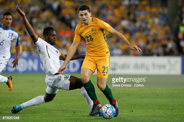 Tom Rogic of the Australia is challenged for the ball by Maynor Figueroa of Honduras during the 2nd leg of the 2018 FIFA World Cup Qualifier between...