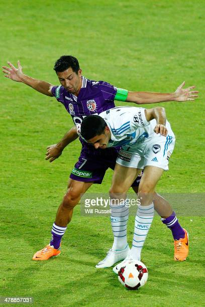 Tom Rogic of the Victory and Jacob Burns of the Glory challenge for the ball during the round 23 ALeague match between Perth Glory and Melbourne...